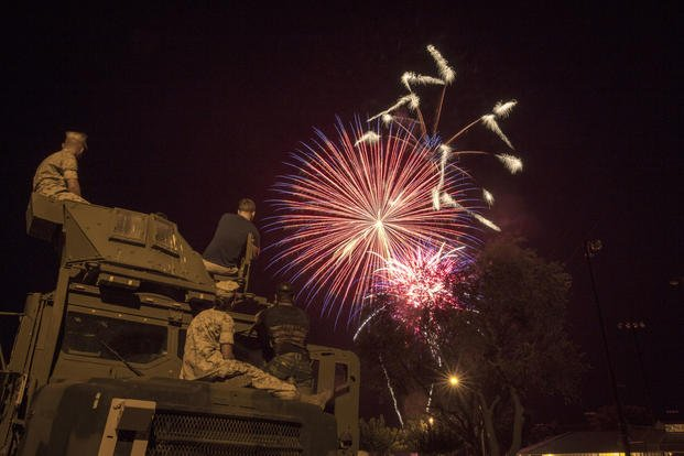 Marines with Marine Wing Support Squadron 374 enjoy the fireworks presentation atop a Medium Tactical Vehicle Replacement during the Twentynine Palms Independence Day celebration at Luckie Park, July 4, 2015. (U.S. Marine Corps photo/Pfc. Levi Schultz)
