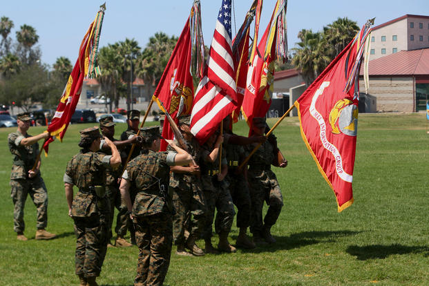 Col. Bobbi Shea and Col. Dawn R. Alonso salute the national and Marine Corps colors in the traditional pass and review during the change of command and re-designation ceremony at Camp Pendleton, July 6, 2017. (U.S. Marine Corps/Robert A Alejandre)