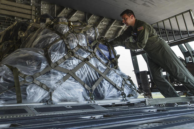 A loadmaster from the 15th Airlift Squadron at Joint Base Charleston loads cargo onto a C-17 July 23, 2017, at Little Rock Air Force Base, Ark. (U.S. Air Force photo/Staff Sgt. Harry Brexel)