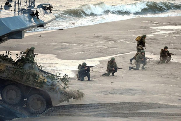 Troops come ashore during the Zapad Russian-Belarusian exercises at the Khmelyovka test ground, Russia, in September 2013. (Courtesy of the Kremlin)