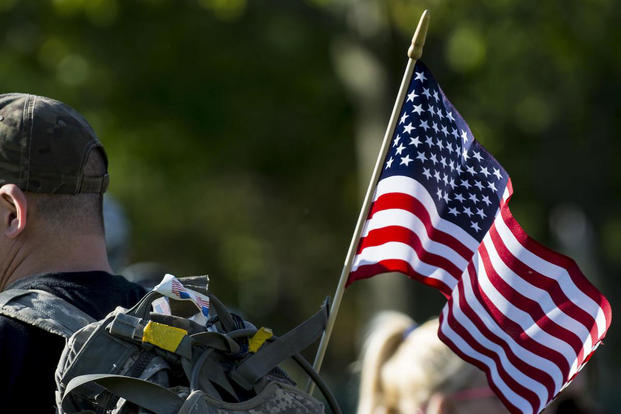 An American flag hangs on the back of a participant during the Chicago Honor the Fallen Ruck March, May 22, 2015. (U.S. Army photo/Sgt. 1st Class Michel Sauret)