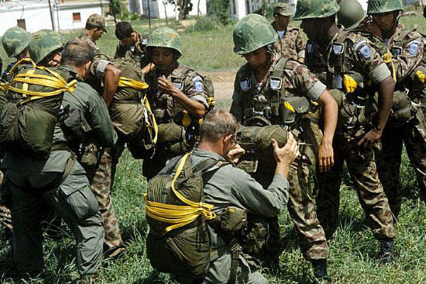 U.S. Army soldiers check the equipment of Colombian paratroopers. DoD photo