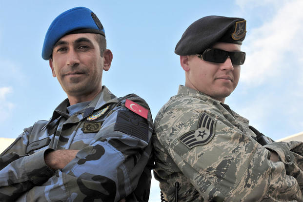 A Turkish Air Force Security Forces patrolman, (left) and Staff Sgt. Ryan Schaefer (right) work as a team during a joint patrol Oct. 22, 2010, at Incirlik Air Base, Turkey. Patrolmen (U.S. Air Force photo/Senior Airman Ashley Wood)