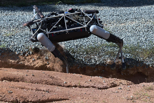 """Spot"", a quadruped prototype robot, maneuvers through a ditch during a demonstration at Marine Corps Base Quantico, Va., Sept. 16, 2015. Photo By: Sgt. Eric Keenan"
