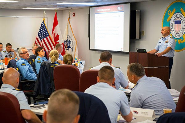Members of the U.S. and Canadian Coast Guards discuss plans for upcoming icebreaking operations during the 2015 Great Lakes International Icebreaking Meeting held Oct. 20-21, 2015. (U.S. Coast Guard/PO3 Christopher M. Yaw)