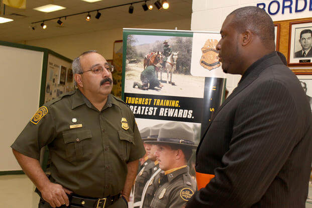 An El Paso Sector Border Patrol agent and recruiter discusses the application process at a 2010 job fair. Photo by Melissa M. Maraj