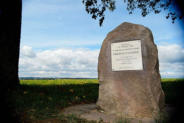 17A memorial stone sits near the location of the crash site of 2nd Lt. Priesley Cooper Jr. Sept. 25, 2015, in Dietingen, Germany. Cooper was killed in action during a strafing run in World War II. (U.S. Air Force/Staff Sgt. Armando A. Schwier-Morales)