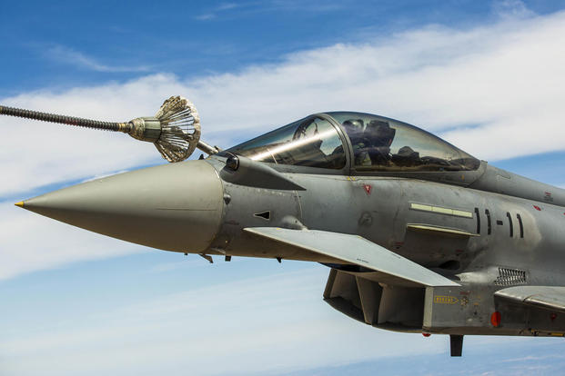 A Eurofighter Typhoon with the Spanish Air Force refuels from a KC-130J Hercules, a first for the Marines from Special-Purpose Marine Air-Ground Task Force Crisis Response-Africa. (Photo: Staff Sgt. Vitaliy Rusavskiy)