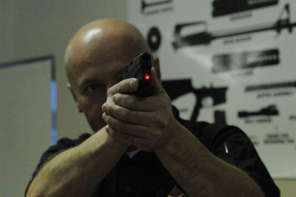 Peter Desjardin, Air Force Global Strike Command, aims a laser sight during a Women's Introduction to Firearms class on Barksdale Air Force Base, La., April 26, 2013. (U.S. Air Force photo/Airman 1st Class Andrew Moua)