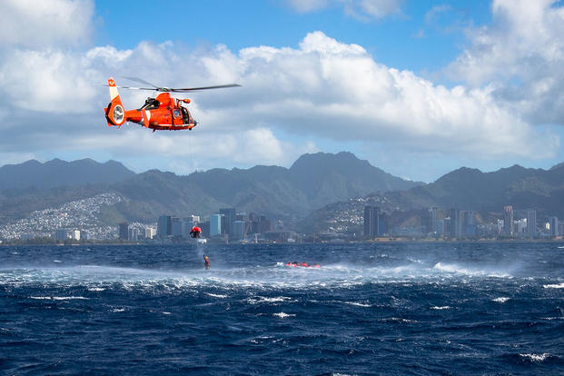 A Coast Guard rescue team from Coast Guard Station Barbers Point extracts U.S. Army pilots of 2-6 Cavalry Regiment, 25th Combat Aviation from the ocean off the coast of Honolulu Feb 17. (U.S. Army photo by Sgt. Daniel K. Johnson)