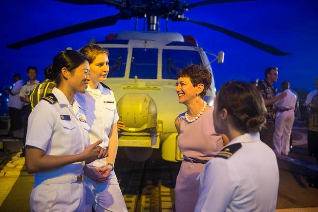 Ambassador Judith Cefkin, U.S. ambassador of Fiji, meets with junior officers on the flight deck of the guided-missile destroyer USS William P. Lawrence. (Photo: Mass Communication Specialist 3rd Class Emiline L. M. Senn)