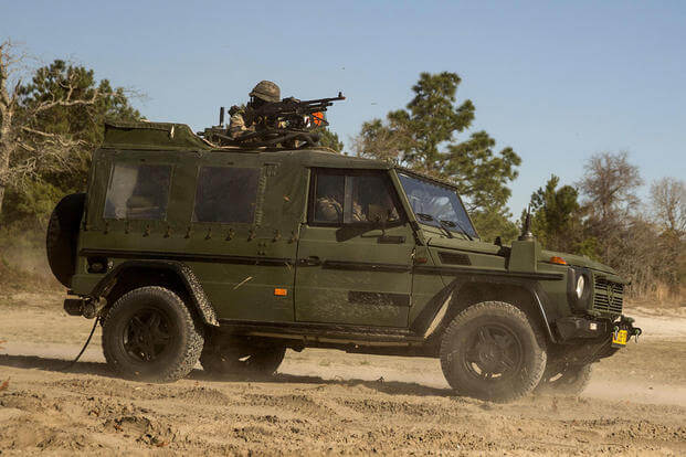 Dutch Marines with 32nd Raiding Company provide security in a Mercedes-Benz G-class utility vehicle during a casualty evacuation exercise at Marine Corps Base Camp Lejeune, North Carolina. (U.S. Marine Corps photo by Cpl. Justin Updegraff)
