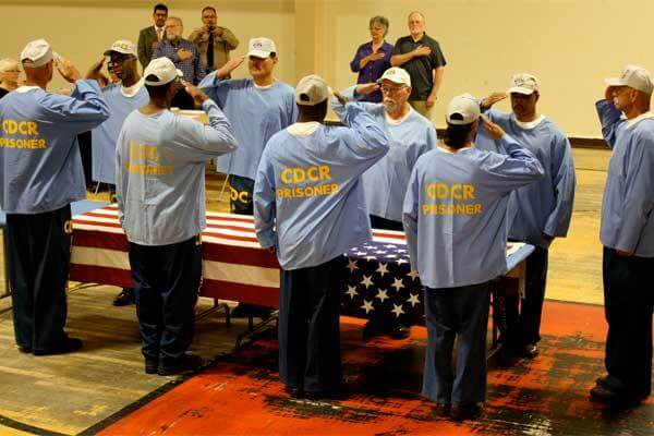 Members of the Incarcerated Vietnam Veterans of America (IVVA), Chapter 1065, at the Correctional Training Facility (CTF) salute before folding the U.S. flag. (Photo: Inside CDCR)
