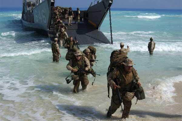 U.S. Marines from Expeditionary Strike Group One, 13th Marine Expeditionary Unit wade ashore in preparation for an amphibious assault landing demonstration in Mubarek Military City, Egypt, on Sept. 13, 2005.  (Airman Apprentice Shannon Garcia, U.S. Navy.)