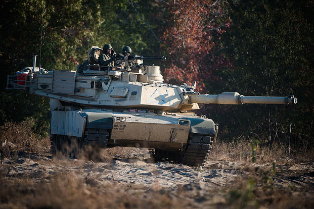 Students from the Armor Basic Leader Course at Fort Benning, Georgia, train during a combined competitive maneuver exercise at Benning's Good Hope Training Area on Nov. 16, 2016. U.S. Army photo