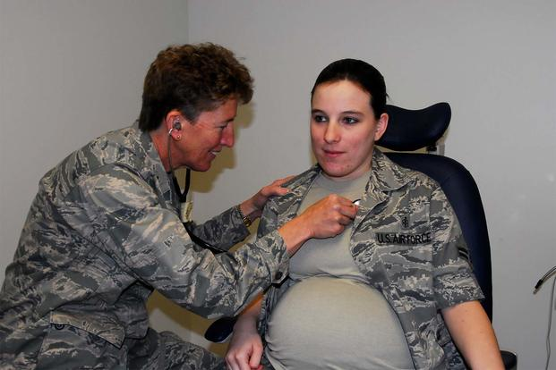 Airman First Class Brandy Fraher, who is in the final stages of her pregnancy, receives an examination from Major Noreen Burke during a unit training assembly. (Air Force Photo)