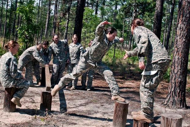 U.S. Army Soldiers negotiate obstacles during the Cultural Support Assessment and Selection program. (Army Photo)
