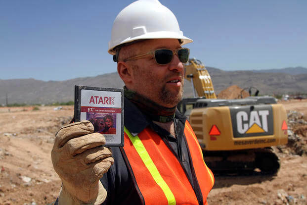 "In an April 26, 2014 file photo, film director Zak Penn shows a box of a decades-old Atari ""E.T. the Extra-Terrestrial"" game found in a dumpsite in Alamogordo, N.M."