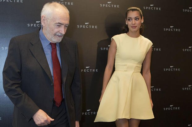 "Producer Michael G. Wilson and ""Bond girl"" Stephanie Sigman arrive for a photo call ahead of a press conference to discuss Sigman's role in the  upcoming 007 film ""Spectre,"" in Mexico City, Wednesday, March 18, 2015."