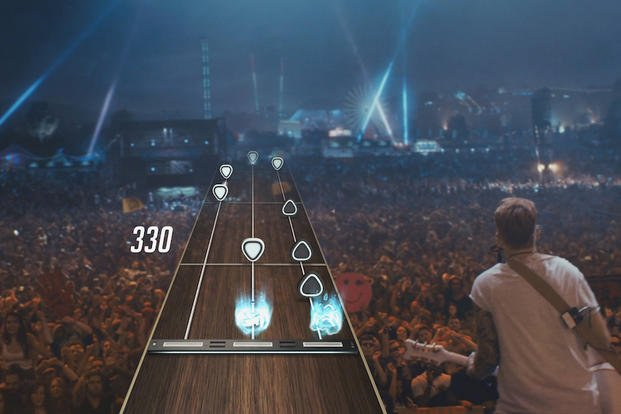 This photo provided by Activision Publishing, Inc. shows an In-game screenshot from Guitar Hero Live from Activision Publishing, Inc. Activision Blizzard Inc. announced plans Tuesday, April 14, 2015 to revive the once-popular video game franchise.