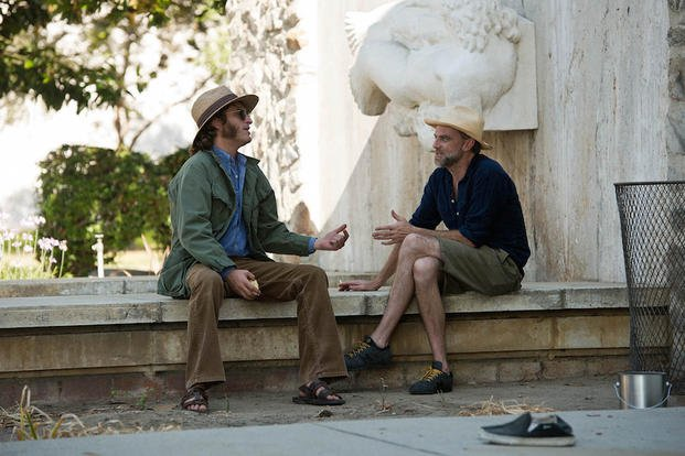 "This photo provided by Warner Bros. Pictures shows, actor Joaquin Phoenix, left, and director/writer/producer, Paul Thomas Anderson, on the set of Warner Bros. Pictures' and IAC Films' ""Inherent Vice,"" a Warner Bros. Pictures release."