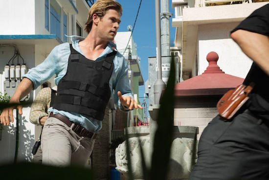 "This photo provided by Universal Pictures shows Chris Hemsworth, left, as Nicholas Hathaway in Legendary's ""Blackhat,"" from director/producer Michael Mann.  (AP Photo/Legendary Pictures - Universal Pictures, Frank Connor)"