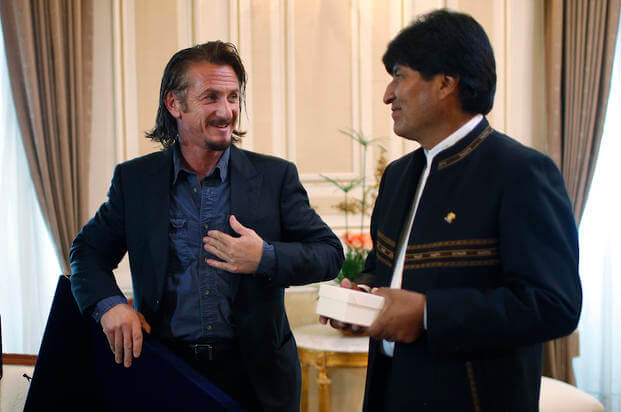 FILE - In this Oct. 30, 2012 file photo, actor Sean Penn talks to Bolivia's President Evo Morales during a photo call at the government palace in La Paz, Bolivia.