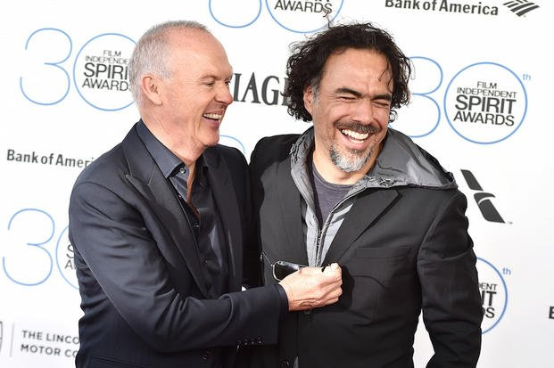 Michael Keaton, left, and Alejandro Gonzalez Inarritu laugh as they arrive at the 30th Film Independent Spirit Awards on Saturday, Feb. 21, 2015, in Santa Monica, Calif. (Photo by Jordan Strauss/Invision/AP)