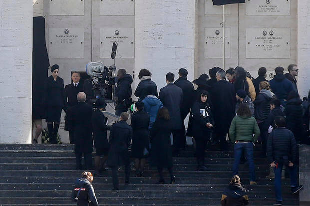 "n this Thursday, Feb. 19, 2015 file photo, actor Daniel Craig, background second center, and actress Monica Bellucci, background left, perform during the shooting of the latest James Bond movie ""SPECTRE"", in Rome."