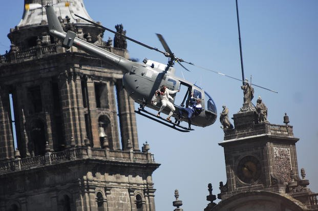 "Stunt doubles perform an action scene aboard a helicopter above the Zocalo, Mexico City's main square during the filming of ""Spectre,"" the latest of the James Bond 007 movies, in Mexico, Monday, March 30, 2015. The latest installment of the"