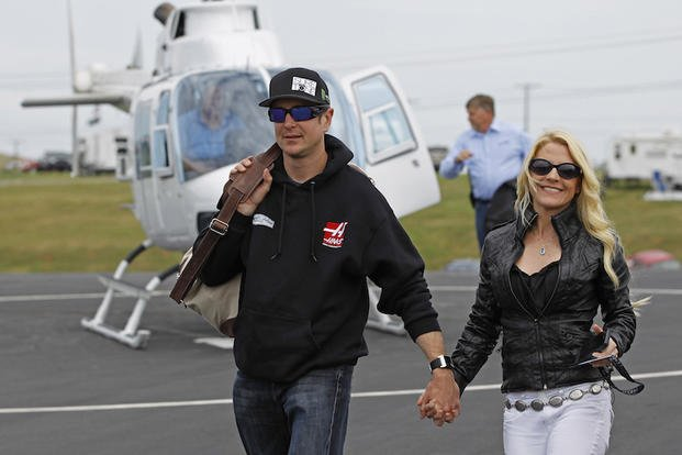 FILE - In this May 17, 2014 file photo, Kurt Busch walks with his girlfriend, Patricia Driscoll, after arriving for the NASCAR Sprint All-Star auto race at Charlotte Motor Speedway in Concord, N.C