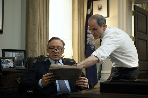 "In this image released by Netflix, Kevin Spacey, left, and Michael Kelly appear in a scene from ""House of Cards."""