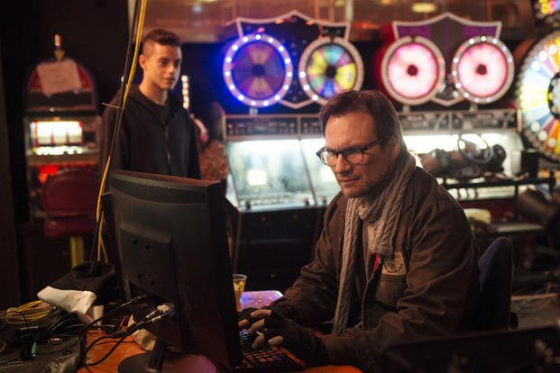"In this image released by USA Network, Rami Malek, left, and Christian Slater  appear in a scene from the hacker drama ""Mr. Robot,"" premiering June 24 at 10 p.m. ET on USA. (AP Photo/USA Network, David Giesbrecht)"