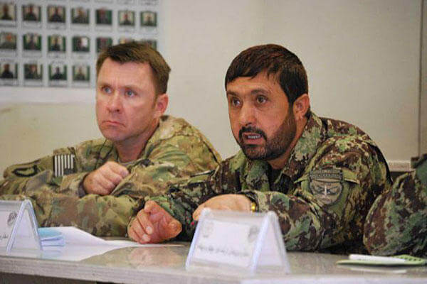 U.S. Army Lt. Col. Matthew Stader, left, listens to a briefing in Jalalabad, Afghanistan, alongside his Afghan counterpart, Brig. Gen. Dadan Luwang, commander of the 4th Brigade, 201st Corps of the Afghan National Army.