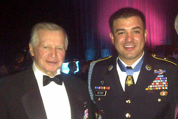 John Mohler poses with MoH recipient Army Sgt. 1st Class Leroy Petry at a 2010 Special Forces Association banquet. He claimed on his SFA application that he served with Special Forces in Vietnam. He served with the 23rd Infantry (Mechanized), 25th ID.