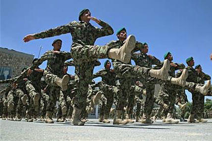 Afghanistan National Army soldiers march during their graduation ceremony at the Kabul Military Training Center in Kabul, Afghanistan, on June 1, 2014. Massoud Hossaini/AP