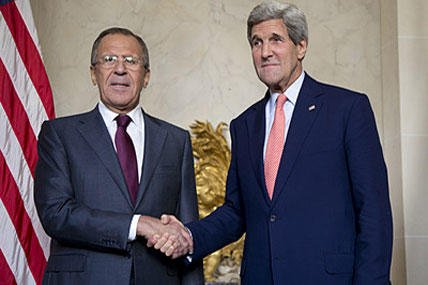 U.S. Secretary of State John Kerry shakes hands with Russian Foreign Minister Sergey Lavrov, left, at the Chief of Mission Residence in Paris, France, Tuesday, Oct. 14, 2014. Carolyn Kaster/AP