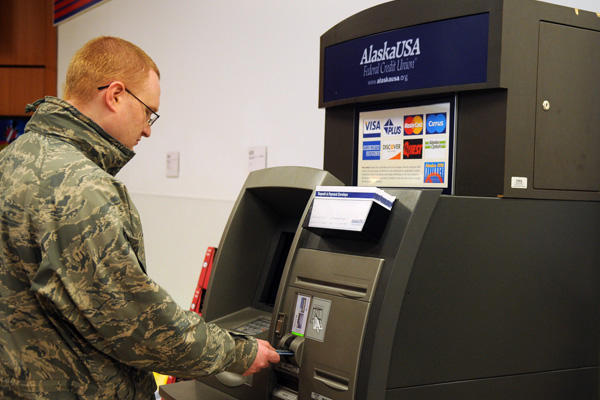 Service member using an ATM.