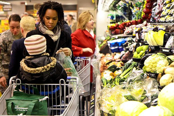 A shopper visits the produce section at the Chievres commissary in Belgium. (U.S. Army Corps of Engineers/Carol E. Davis).
