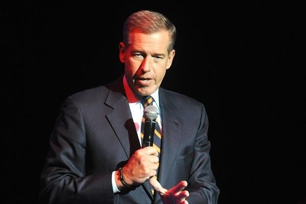 In this Nov. 5, 2014 file photo, Brian Williams speaks at the 8th Annual Stand Up For Heroes, presented by New York Comedy Festival and The Bob Woodruff Foundation in New York. (Photo by Brad Barket/Invision/AP)