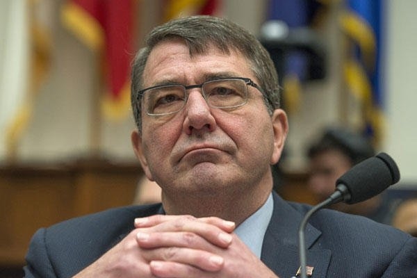 In this March 18, 2015, file photo, Defense Secretary Ash Carter listens on Capitol Hill in Washington. Molly Riley/AP