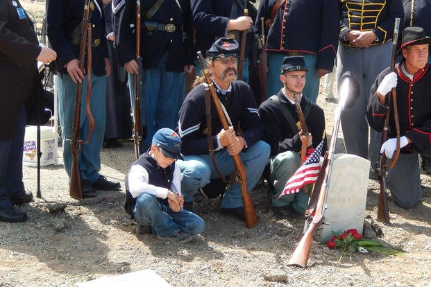 Civil War re-enactors gather June 7, 2015, around the grave of Pvt. Scott Carnal of the 1st Kansas Colored Infantry during a ceremony Sunday in Dayton, Nev., 30 miles south of Reno. Lynne Ballatore/Historical Society of Dayton Valley, via AP