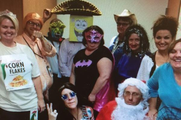 Brandon Coleman, a former Marine and an addictions specialist at the Phoenix VA hospital, says this Halloween photo shows that supervisors let one of his colleagues, Jeremy Pottle (second from left), mock him by dressing as him in custome.