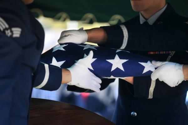 Airmen from the honor guard at Eglin Air Force Base, Florida, finish folding a flag during a memorial service Jan. 22, 2011. (U.S. Air Force photo/Joshua Green)