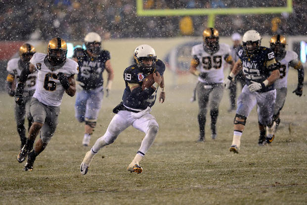Midshipman Keenan Reynolds, Naval Academy quarterback and most valuable player, runs the ball to score the Navy's second touchdown during the 114th Army-Navy football game on Dec. 14, 2013. Marvin Lynchard/DoD