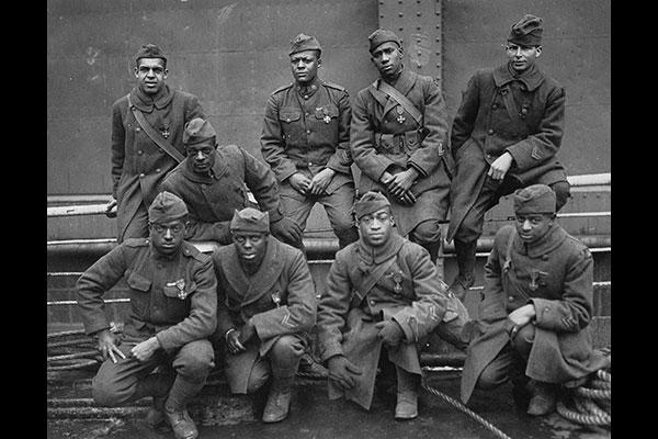 Members of the 369th Infantry Regiment, formerly known as the 15th New York National Guard Regiment, who won the Croix de Guerre for gallantry in action during World War I. Photo circa 1919. (National Archives)