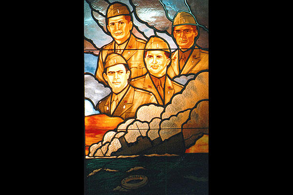 A stained glass window of the four chaplains located in the A-ring of the Pentagon on the third floor. (DoD)