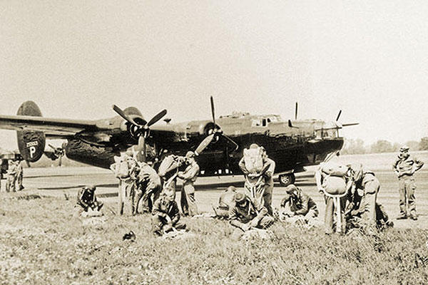 Jedburgh teams suit up in England prior to boarding a 'Carpetbagger' B-24 Liberator drop aircraft, August 1944. (U.S. Army photo)