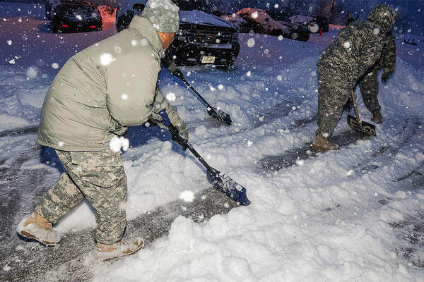 Members of the Maryland National Guard help to clear snow in February 2014; they are being called on to do so again for this weekend's snow emergency throughout the state. (Maryland National Guard/Edwin Gray)