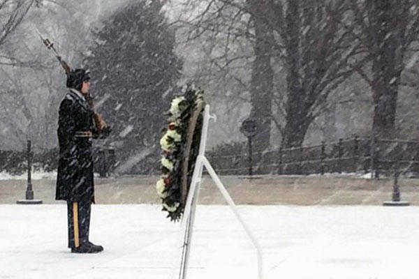 An honor guard watches over the Tomb of the Unknowns at Arlington National Cemetery during Winter Storm Jonas on Jan. 23. By noon of that day, the National Guard had more than 2,000 troops helping 12 states cope with the snow emergency. (Army photo)